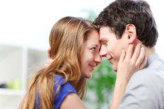 Attractive couple of lovers look at each other with love Stock Images