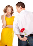 Attractive  couple of lovers. Man presents flower. Royalty Free Stock Photography