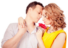 Attractive  couple of lovers. Man presents flower.  Stock Image