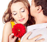 Attractive  couple of lovers. Man presents flower. Valentine s d Stock Image