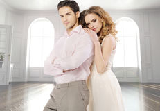 Attractive couple in the luxury apartment Stock Photography