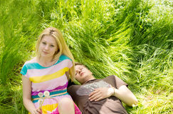 Attractive couple lying down on the grass Royalty Free Stock Images