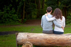 Attractive couple lying in grass at the park Royalty Free Stock Images