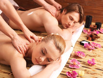 Attractive couple lying  in a spa salon. Royalty Free Stock Images