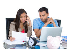 Attractive couple, man and woman, looking distressed from financial problems and mounting bills Royalty Free Stock Photos