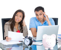 Attractive couple, man and woman, looking distressed from financial problems and mounting bills Stock Image