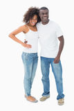 Attractive couple in matching clothes smiling at camera Royalty Free Stock Photos