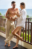 Attractive couple in morning on terrace Stock Photography