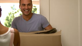 Attractive couple moving boxes into their new house. Slow motion of attractive couple moving boxes into their new house stock footage