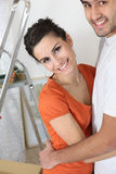 Attractive couple moving into new home Royalty Free Stock Image