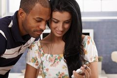 Attractive couple with mp3 player Stock Photography