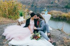 Attractive couple newlyweds laugh and smile happy and joyful moment. Autumn wedding ceremony outdoors. Stylish bride and Stock Images