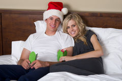 Attractive couple opening Christmas gifts Stock Image