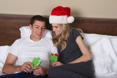 Attractive couple opening Christmas gifts Stock Images