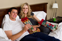 Attractive couple opening Christmas gifts Stock Photos