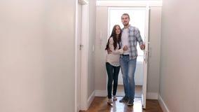 Attractive couple opening the front door stock video footage