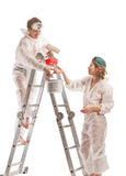 Attractive couple painting interior wall. Royalty Free Stock Photo