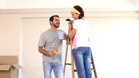 Attractive couple painting their living room stock footage
