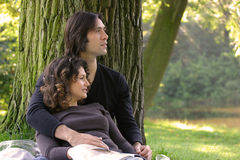 Attractive couple in the park Royalty Free Stock Photo