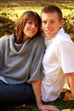 Attractive Couple in the Park. Very attractive couple in love posing for portraits Royalty Free Stock Photos