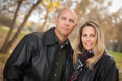 Attractive Couple in Park with Leather Jackets stock photos