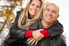 Attractive Couple in Park with Leather Jackets Royalty Free Stock Photo