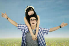 Attractive couple piggyback outdoors Royalty Free Stock Image