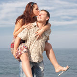 An attractive couple playing on the beach Stock Photos