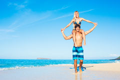 Attractive Couple Playing on the Beach Stock Photos