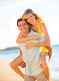 Attractive Couple Playing on the beach at Sunset Stock Images