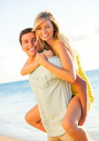 Attractive Couple Playing on the beach at Sunset Royalty Free Stock Photo