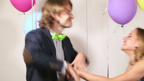 Attractive couple playing tug of war with shiny brace string stock video footage