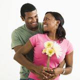 Attractive couple portrait. Portrait of smiling African American couple standing looking at each other Royalty Free Stock Photography