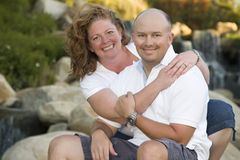Attractive Couple Portrait in Park. Attractive Couple Pose for Portrait in the Park Stock Photos