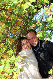 Attractive couple posing amongst foliage Stock Photography