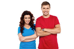 Attractive couple posing with arms crossed Royalty Free Stock Photography