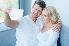 Attractive couple posing for a selfie Stock Photo