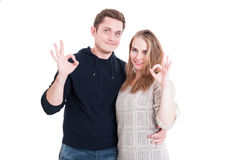 Attractive couple posing and showing ok gesture Royalty Free Stock Images