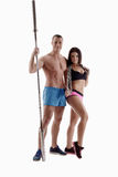 Attractive couple posing with sports equipment Stock Images