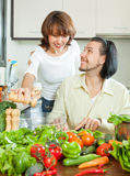 Attractive couple preparing a meal of vegetables Royalty Free Stock Image