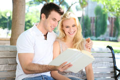 Attractive Couple Reading Stock Photos