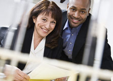Attractive couple reading paper. Stock Photography