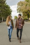 Young couple walking in the city park royalty free stock image
