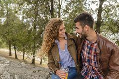 Attractive couple refreshing in the park stock photos