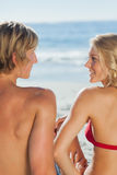 Attractive couple relaxing on the beach together Royalty Free Stock Photography