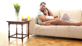 Attractive couple relaxing on the couch stock video footage
