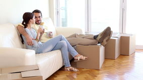 Attractive couple relaxing on couch stock video footage