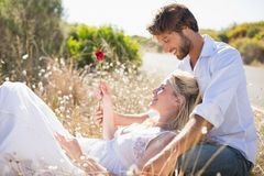Attractive couple relaxing in the countryside stock photos