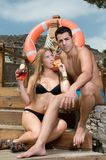 Attractive couple relaxing by the pool Royalty Free Stock Photo