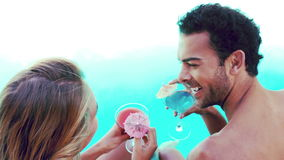 Attractive couple relaxing by the pool. In slow motion stock video footage